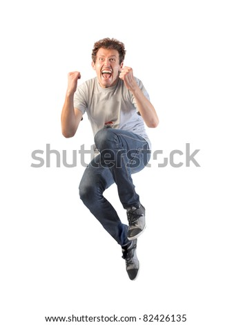 Happy young man jumping - stock photo