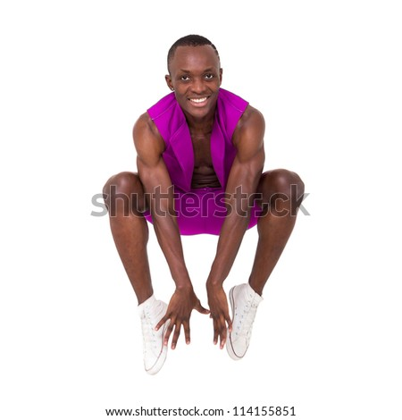 Happy young man jumping against isolated white background