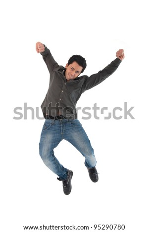 Happy young man jumping against white background.