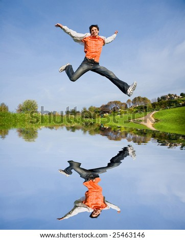 Happy young man - jumping  end fly in blue sky - stock photo