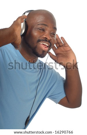 Happy young man laughing while listening to music - stock photo