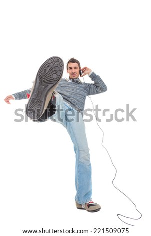 Happy young man listen music in headphones