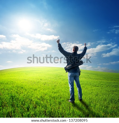 Happy young man looking at the sun