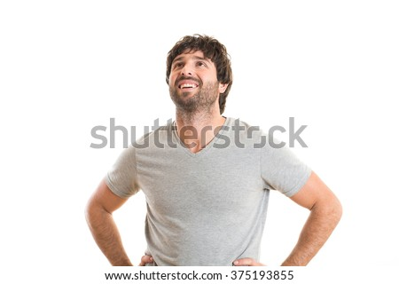 happy young man looking up - stock photo