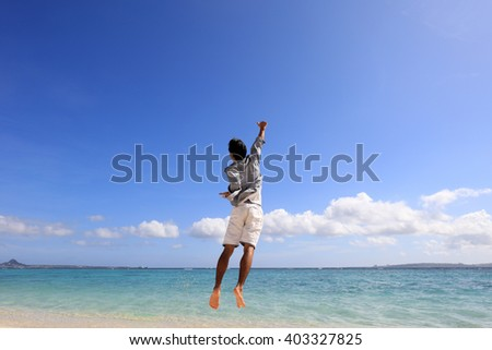 Happy young man on a tropical beach