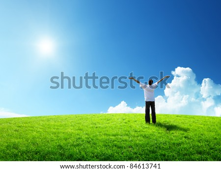 happy young man on green field - stock photo