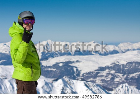 Happy young man on ski resort in high Alpine mountains - stock photo