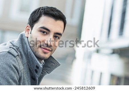 Happy young man, outdoor - outside. Close up of gorgeous male in coat, coldly morning - stock photo