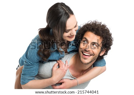 Happy Young Man Piggybacking Her Girlfriend Isolated On White Background - stock photo