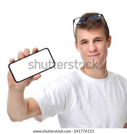 Happy young man show display of mobile cell phone with blank screen and smiling isolated on a white background. Focus on hand with mobile phone - stock photo