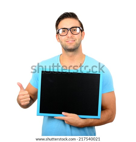 Happy young man showing and displaying blank black board with thumb up ready for your text or product isolated on white background - stock photo