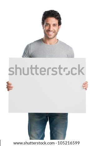 Happy young man showing and displaying placard ready for your text or product - stock photo