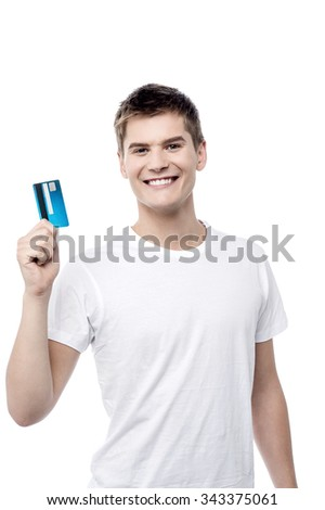 Happy young man showing credit card