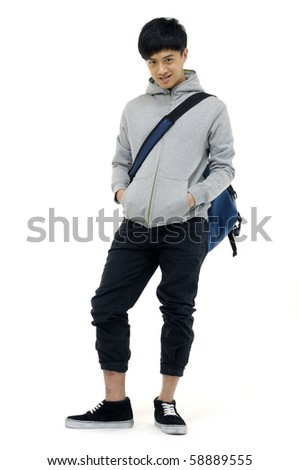 Happy young man standing with bag,