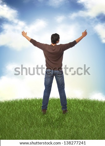 happy young man standing with open arms - stock photo