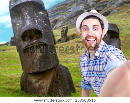 Happy young man taking a selfie photo in Easter Island, Chile - stock photo