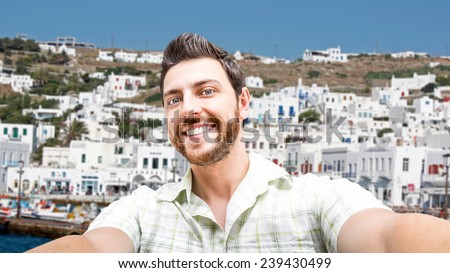 Happy young man taking a selfie photo in Greece - stock photo