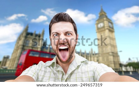 Happy young man taking a selfie photo in London, England - stock photo