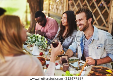 Happy young man talking to girl at Thanksgiving party - stock photo