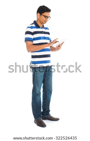 Happy young man using digital tablet against white background. - stock photo