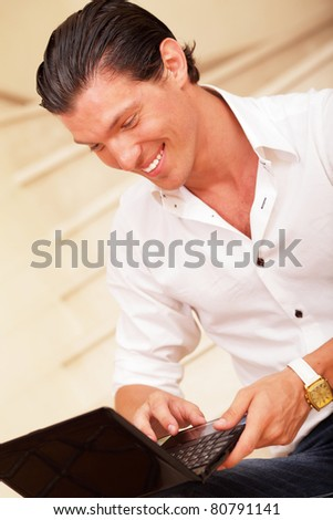 Happy young man using laptop computer