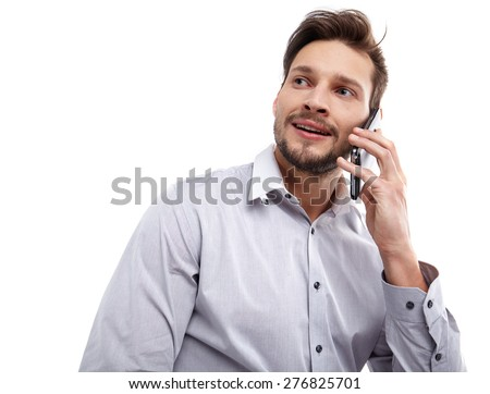 Happy Young Man Using Mobile Phone Isolated On White Background - stock photo