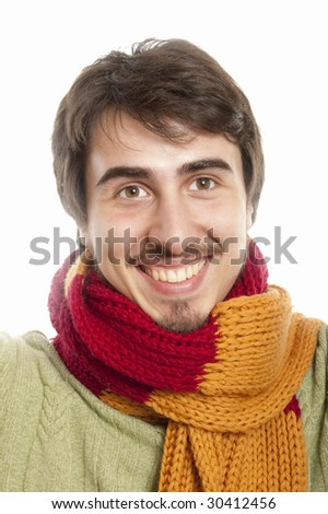 Happy young man wearing a scarf and green pullover - stock photo