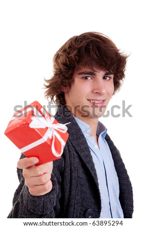 happy young man, with a red gift isolated on white background, studio shot. - stock photo