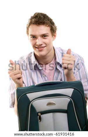 happy young man with a suitcase - stock photo