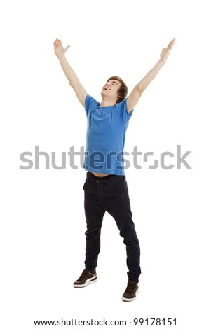 Happy young man with arms raised in the air, isolated on white background - stock photo