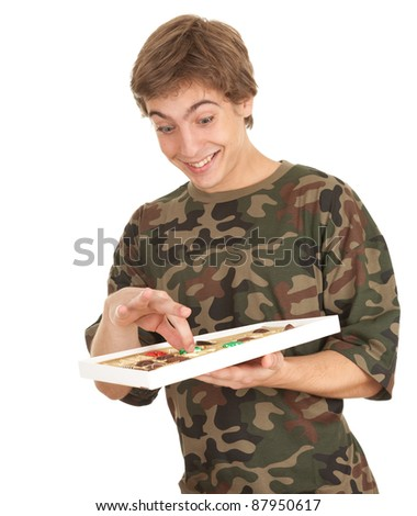 happy young man with chocolates, white background - stock photo