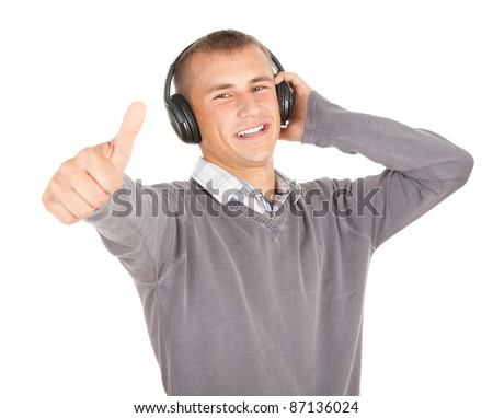 happy young man with headphones and thumb up, white background
