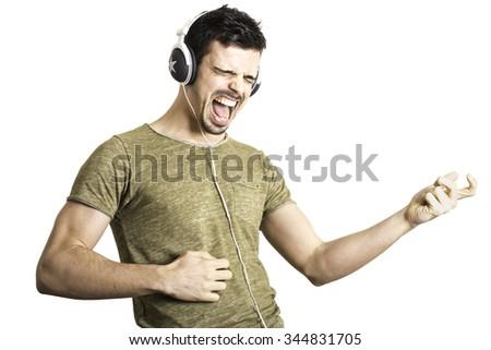 happy young man with headphones that simulating play the guitar  - stock photo