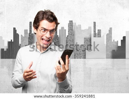 happy young man with mobile - stock photo