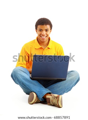 Happy young man working on a laptop, isolated against white background - stock photo