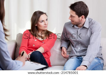 Happy young marriage starting new life after therapy session - stock photo