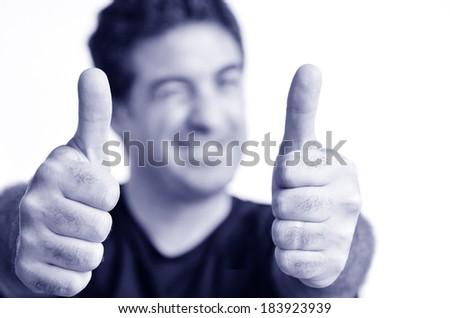 Happy young mature man showing thumbs up.Copy space on white background.real people.Concept photo of success, approval, youth, coolness, positivity,happiness,agreement,confident,achievement. (BW) - stock photo