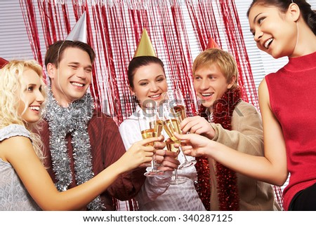 Happy young men and women having birthday party - stock photo