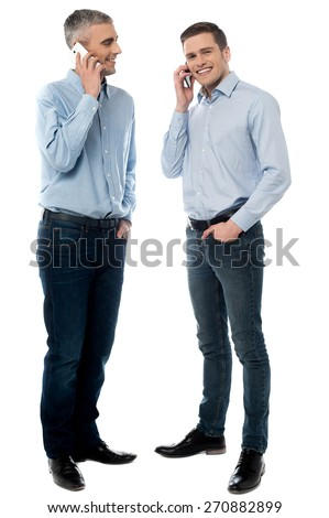 Happy young men communicate via cell phone - stock photo