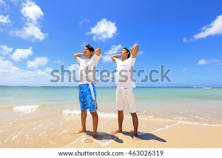 Happy young men on a tropical beach