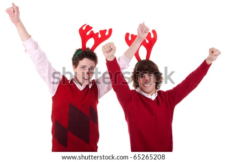 happy young men wearing reindeer horns, with arms raised, on white, studio shot - stock photo