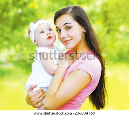 Happy young mom and child in the summer sunny day - stock photo