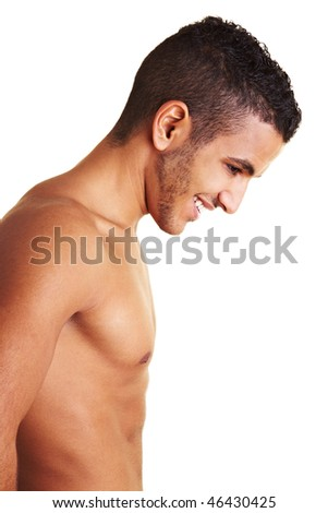 Happy young morooccan mal with naked upper body - stock photo