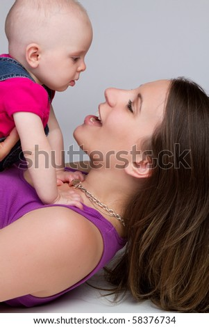 Happy young mother and baby - stock photo