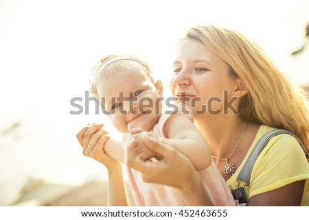 Happy young mother and baby daughter - stock photo