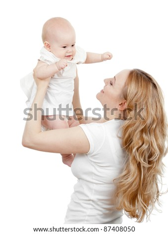 Happy young mother and baby in her hands - stock photo