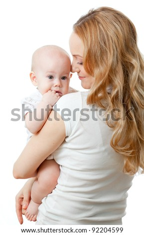 Happy young mother and baby in her hands