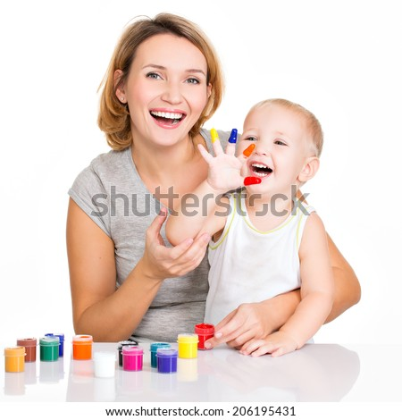 Happy young mother and child with painted hands - isolated on white. - stock photo