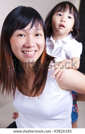 Happy young mother and daughter.