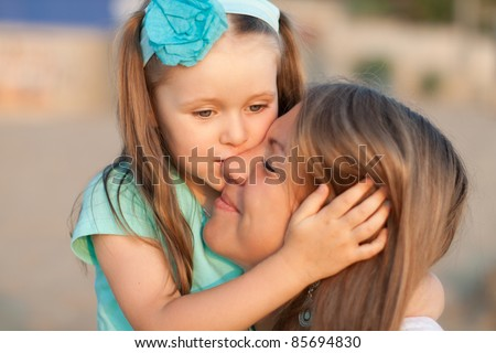Happy young mother and daughter - stock photo